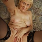 Old saggy granny in black stockings shows us the goodies