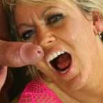 Old cougar in a pink fishnet outfit gets a mouth full of love juice