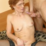 Sexy granny in black stockings loves the taste of his young rod