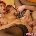 Redhead mommy in black lingerie loves this blonde's dudes rock solid manhood
