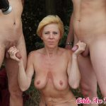 Two lads take a blonde mom out to the woods where they fuck her hard