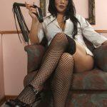 Milf in fishnet stockings summons her black slave to worship her feet